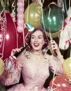1950s Happy Woman In Party Dress at New Years Eve Celebration